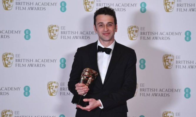 64857014_US-composer-Justin-Hurwitz-poses-with-the-award-for-Original-Music-for-the-film-27La-La
